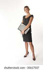 Serious businesswoman holding a laptop computer on white background