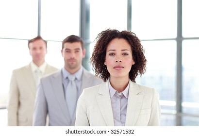 Serious businesswoman in a line with her colleagues