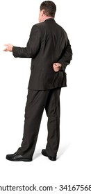 Serious Caucasian elderly man with short medium brown hair in business formal outfit with hands behind back - Isolated