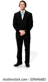 Serious Caucasian man with short black hair in business formal outfit using headset - Isolated