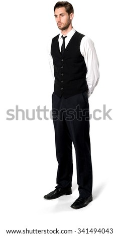 de63371d9cc Serious Caucasian man with short dark brown hair in business casual outfit  with hands behind back