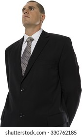Serious Caucasian man with short medium brown hair in business formal outfit with hands behind back - Isolated