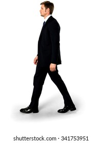 Serious Caucasian man with short medium blond hair in business formal outfit walking - Isolated