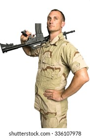 Serious Caucasian Soldier with short dark brown hair in Desert Camouflage Uniform holding machine gun - Isolated