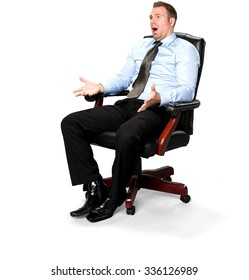 Serious Caucasian young man with short medium brown hair in business formal outfit sitting in chair and talking with hands - Iso