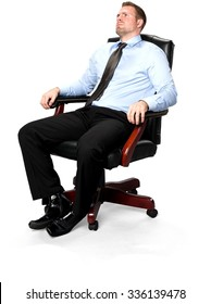 Serious Caucasian young man with short medium brown hair in business formal outfit sitting in chair - Isolated