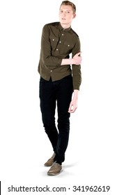 Serious Caucasian young man with short light blond hair in casual outfit holding arm - Isolated