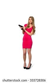 Serious Caucasian young woman with long light blond hair in evening outfit holding handgun - Isolated