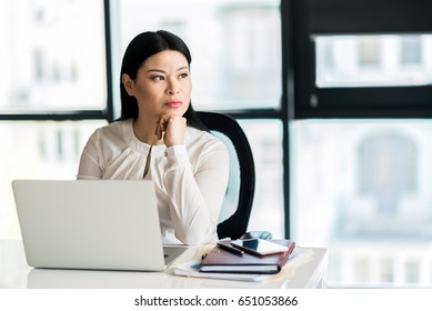 Serious confident lady concentrating on her thoughts