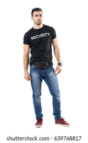 Serious confident young plainclothes officer with fanny pack looking at camera. Full body length portrait isolated on white studio background.