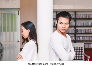 Serious couple talking in the living room