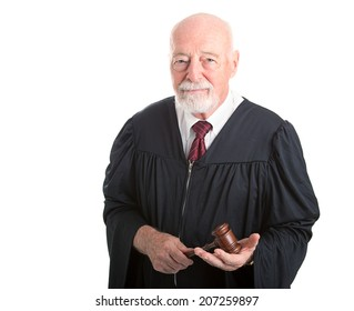 Serious dignified judge with gavel.  Isolated on white.