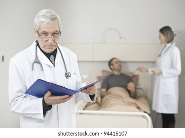 Serious doctor with medical report