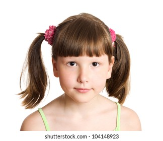 Serious eight years girl portrait isolated