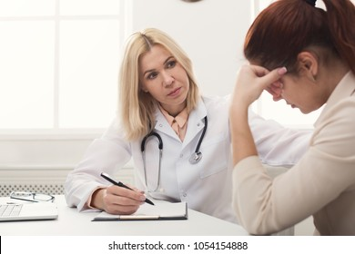 Serious female doctor consulting and diagnose desperate woman, saying bad test results, relapse, healthcare and medical concept, copy space
