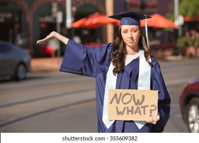Serious female student holding hand out with cardboard sign