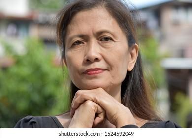 A Serious Filipina Female Senior