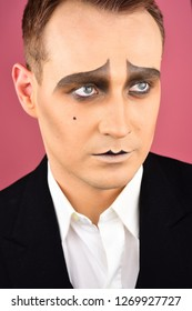 Serious and genuine. Drama or tragedian performer. Theatre actor miming. Mime with face paint. Mime artist. Man with mime makeup. Stage actor playing. Theatrical performance art and pantomime.