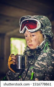 Serious girl in military uniform hold mug with hot drink. Disappointed and upset teenager girl. Disillusioned stalker in abandoned building. Girl with tired facial expression. Young stalker concept