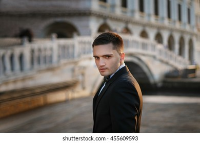 Serious glance of the groom in the tuxedo