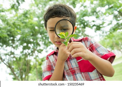 Serious guy exploring the environment with a magnifying glass