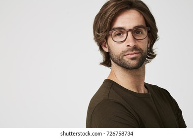 Serious guy in spectacles and t-shirt, portrait