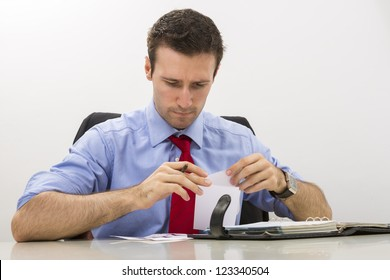 Serious handsome executive showing focused attitude on paperwork.