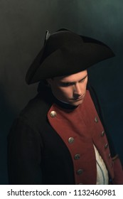 Serious historical regency man in hat and jacket. High angle view.