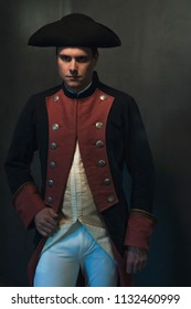 Serious historical regency man in hat and jacket.
