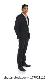 serious indian male business man with isolated white background full body