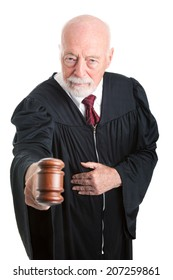 Serious judge banging his gavel in court.  Isolated on white.