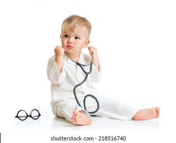 serious kid playing doctor with stethoscope isolated