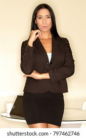 Serious latina business woman in her office