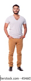 Serious latino cutout man with beard. Hands are in the pockets. Isolated on white background. Full length.