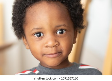 Serious little black boy with an afro