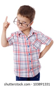 Serious little boy in glasses with empty pointing hand, isolated on white