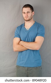Serious looking young male with arms folded