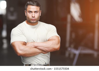 Serious Male Athlete Standing At Gym