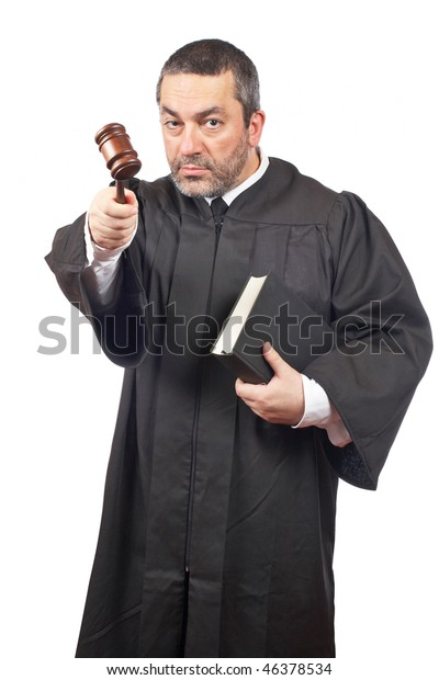 A serious male judge holding the gavel and book, isolated on white background