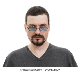 serious man with a beard with Gray glasses. humorous ironic funny male portrait on a white background.
