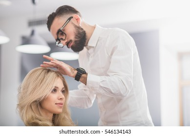 Serious man with beard at hairdresser salon