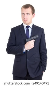 serious man in business suit with gun isolated on white background