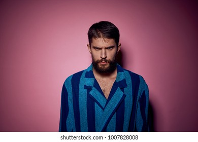 serious man in a dressing-gown on a blue background