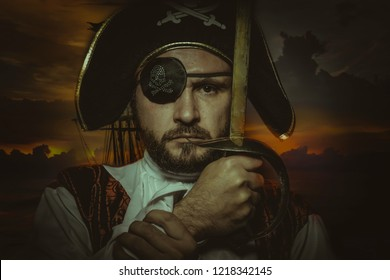 Serious, man pirate with eye patch and old hat with funny faces and expressive