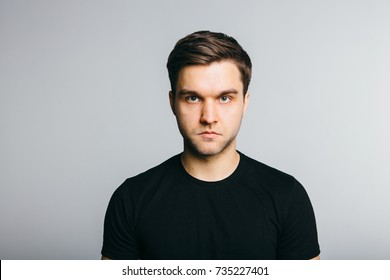 Serious man portret on grey background. - Shutterstock ID 735227401