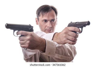 The serious man in a shirt crossed hands to the weapon