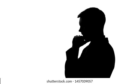 Serious man silhouette thinking over creative idea, startup, business planning