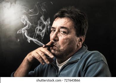 serious man smoking a cigar