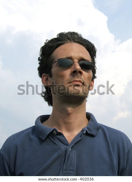 Serious man with sunglasses