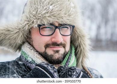 serious man winter beard, close-up portrait